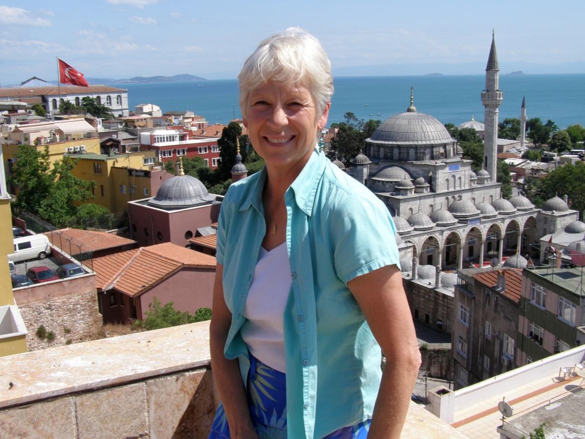 Me sitting on Musa Basaran's 6th floor terrace overlooking tthe Marmara, annmariemershon.com, amershon.edublogs.org, You must only to love them, Istanbul's Bazaar Quarter, Britta's Journey